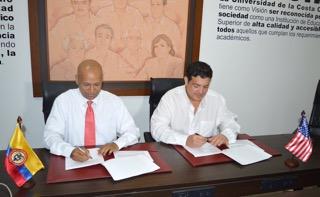 Carlos-CU_and_FIU_signing