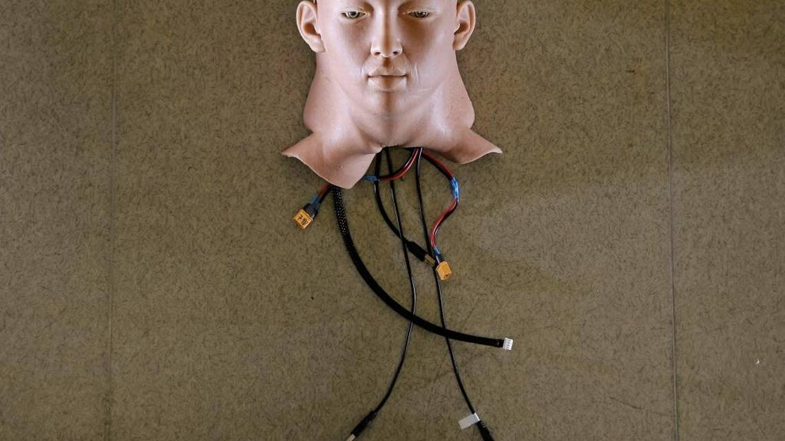 Photo of AI head with wired connections