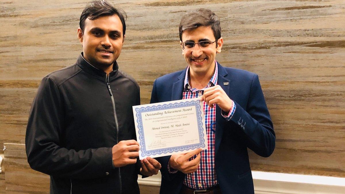Photo of PH.D. student Ahmed Imteaj and his advisor M. Hadi Amini
